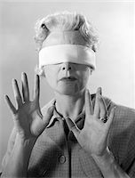 right - 1960s ELDERLY WOMAN WEARING BLINDFOLD HOLDING UP HER HANDS Stock Photo - Premium Rights-Managednull, Code: 846-05646430