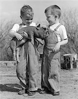 farm and boys - 1950s BOYS IN STRIPED OVERALLS HOLDING PIGLET Stock Photo - Premium Rights-Managednull, Code: 846-05646463