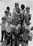 1960s - 1970s OVERHEAD OF MULTI-ETHNIC GROUP OF BOY AND GIRL STUDENTS OUTDOOR Stock Photo - Premium Rights-Managed, Artist: ClassicStock, Code: 846-05646497