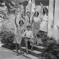 1960s FAMILY GROUP OF PEOPLE STANDING ON STEPS OF HOUSE WAVING Stock Photo - Premium Rights-Managednull, Code: 846-05646499