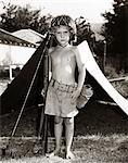 1950s BOY PLAYING SOLDIER STANDING WITH RIFLE HELMET CANTEEN TENT Stock Photo - Premium Rights-Managed, Artist: ClassicStock, Code: 846-05646527
