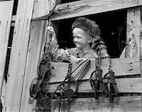 statue of david - 1950s BOY DRESSED IN COONSKIN HAT & FRINGED VEST LIKE DAVY CROCKETT OUTDOORS IN BARN WINDOW Stock Photo - Premium Rights-Managednull, Code: 846-05646555