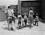 1950s FAMILY MOTHER FATHER 3 CHILDREN FROM BEHIND CARRYING GARDENING HOME IMPROVEMENT TOOLS EQUIPMENT