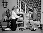 1950s TEENAGE COUPLE PLAYING HI-FI RECORDS ON CONSOLE PHONOGRAPH IN LIVING ROOM Stock Photo - Premium Rights-Managed, Artist: ClassicStock, Code: 846-05646579