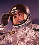 1960s MAN ASTRONAUT LIFTING UP VISOR HELMET WEARING SILVER NAVY SPACE SUIT