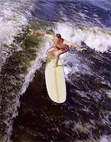 1950s - 1960s YOUNG MAN RED SWIM TRUNKS YELLOW SURFBOARD RIDING A WAVE SURFING Stock Photo - Premium Rights-Managednull, Code: 846-05646589