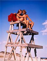 1970s TEEN COUPLE ON LIFE GUARD STAND Stock Photo - Premium Rights-Managednull, Code: 846-05646634