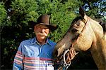 1990s MATURE MAN COWBOY WITH HORSE LOOKING AT CAMERA Stock Photo - Premium Rights-Managed, Artist: ClassicStock, Code: 846-05646737