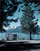1950s FAMILY WITH CAMPING TRAILER BY LAKE GRAND TETON NATIONAL PARK WYOMING Stock Photo - Premium Rights-Managednull, Code: 846-05646740