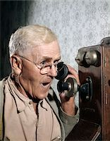 release - 1940s - 1950s MAN USING OLD-FASHIONED WALL MOUNTED TELEPHONE Stock Photo - Premium Rights-Managednull, Code: 846-05646749