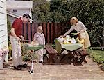 1960s FAMILY FATHER MOTHER TWO DAUGHTERS BARBEQUE IN BACKYARD ON BRICK PATIO Stock Photo - Premium Rights-Managed, Artist: ClassicStock, Code: 846-05646755