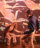 1960s - 1970s MAN WOMAN DANCING WITH PSYCHEDELIC BACKGROUND Stock Photo - Premium Rights-Managednull, Code: 846-05646800