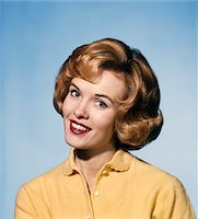 1960s SMILING BLOND WOMAN WEARING A YELLOW SWEATER HEAD TILTED QUIZZICAL EXPRESSION Stock Photo - Premium Rights-Managednull, Code: 846-05646950