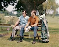 1960s TWO MEN SITTING UNDER TREE WAITING TO TEE-OFF Stock Photo - Premium Rights-Managednull, Code: 846-05646964