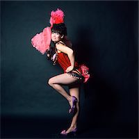 saloon - 1960s WOMAN IN AMERICAN 1890s - 1900s WILD WEST SALOON SHOWGIRL STYLE COSTUME WITH PINK OSTRICH FEATHER FAN Stock Photo - Premium Rights-Managednull, Code: 846-05646977