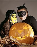 preteen girl pussy - TWO YOUNG GIRLS IN WITCH AND BLACK CAT HALLOWEEN COSTUMES WITH CARVED JACK-O-LANTERN PUMPKIN S Stock Photo - Premium Rights-Managednull, Code: 846-05647012