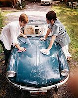 1970s TWO TEENAGED BOYS WASHING TRIUMPH SPORTS CAR  CONVERTIBLE Stock Photo - Premium Rights-Managednull, Code: 846-05647137