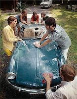 1970s TEENAGE GROUP OF 3 BOYS AND 3 GIRLS TOGETHER WASHING TRIUMPH SPITFIRE SPORTS CAR Stock Photo - Premium Rights-Managednull, Code: 846-05647138