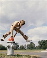 1970s BOY JUMPING OVER FIRE HYDRANT Stock Photo - Premium Rights-Managednull, Code: 846-05647142