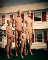 1970s MANNEQUIN FAMILY MOTHER FATHER TWO CHILDREN IN FRONT OF SUBURBAN HOUSE OUTDOOR Stock Photo - Premium Rights-Managednull, Code: 846-05647146