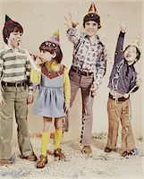 1970s 4 KIDS WEARING PARTY HATS TOSSING CONFETTI Stock Photo - Premium Rights-Managednull, Code: 846-05647152