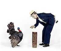 1930s - 1940s MAN CHARACTER WITH HATCHET TRYING TO CATCH A THANKSGIVING TURKEY Stock Photo - Premium Rights-Managednull, Code: 846-05647180