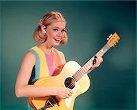 1960s PERKY YOUNG BLOND TEENAGER FOLK SINGER PLAYING GUITAR Stock Photo - Premium Rights-Managednull, Code: 846-05647191