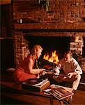 1960s - 1970s COUPLE MAN WOMAN BY LIVING ROOM FIREPLACE PLAYING VINYL RECORD ALBUM MUSIC ON HIGH FIDELITY STEREO TURNTABLE Stock Photo - Premium Rights-Managed, Artist: ClassicStock, Code: 846-05647215