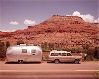 1970s STATION WAGON TRAILER RV NEW MEXICO HIGHWAY TOURIST MAN WOMAN BY MESA FORMATION AIRSTREAM Stock Photo - Premium Rights-Managednull, Code: 846-05647233