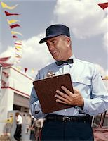 rural gas station - 1950s - 1960s MAN SERVICE MANAGER AT AUTOMOBILE GAS AND REPAIR SERVICE STATION WRITING ON CLIPBOARD Stock Photo - Premium Rights-Managednull, Code: 846-05647242