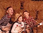 1950s - 1960s TWO BROTHERS AND A SISTER PLAYING INSTRUMENTS GUITARS AND BANJO SINGING COUNTRY MUSIC Stock Photo - Premium Rights-Managed, Artist: ClassicStock, Code: 846-05647251