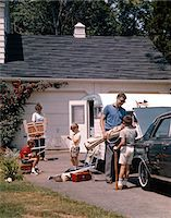 1960s FAMILY FATHER MOTHER 3 SONS LOADING CAR AND TRAILER FOR CAMPING VACATION Stock Photo - Premium Rights-Managednull, Code: 846-05647257