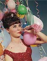 1960s WOMAN BLOWING NEW YEARS PARTY NOISEMAKER Stock Photo - Premium Rights-Managednull, Code: 846-05647266