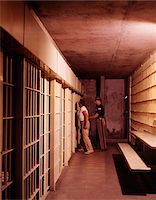 1970s PRISON INTERIOR PRISONER ESCORTED TO JAIL CELL BY POLICE GUARD Stock Photo - Premium Rights-Managednull, Code: 846-05647289