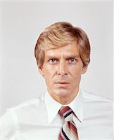 1970s PORTRAIT OF INTENSE BLOND BUSINESSMAN SALESMAN IN SHIRT SLEEVES LOOKING AT CAMERA Stock Photo - Premium Rights-Managednull, Code: 846-05647297