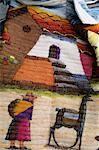CHILE DETAIL OF HAND-WOVEN BLANKET SHOWING NATIVE WOMAN AND LLAMA