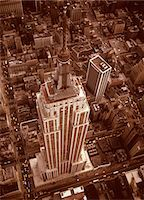 1970s AERIAL SHOT FROM HELICOPTER LOOKING DOWN FULL LENGTH OF EMPIRE STATE BUILDING MIDTOWN MANHATTAN NEW YORK CITY Stock Photo - Premium Rights-Managednull, Code: 846-05647366