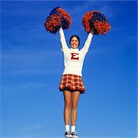 1960s - 1970s TEEN GIRL CHEERLEADER FULL FIGURE HEAD TO TOE SADDLE OXFORD SHOES PLAID SHORT SKIRT POMPOMS Y STANCE ARMS UP Stock Photo - Premium Rights-Managednull, Code: 846-05647404
