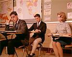 1960s 3 COLLEGE HIGH SCHOOL STUDENTS SITTING DESK CHAIRS READING STUDYING CLASSROOM Stock Photo - Premium Rights-Managed, Artist: ClassicStock, Code: 846-05647431