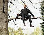 1960s MAN IN TREE SAWING OFF THE BRANCH HE IS SITTING ON Stock Photo - Premium Rights-Managed, Artist: ClassicStock, Code: 846-05647442
