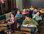 1940s - 1950s HIGH SCHOOL CLASSROOM OF BORED STUDENTS SITTING AT DESKS Stock Photo - Premium Rights-Managed, Artist: ClassicStock, Code: 846-05647479