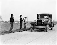 1930s - 1920s MAN DRIVING FORD MODEL A CAR 3 BOYS HITCHHIKING Stock Photo - Premium Rights-Managednull, Code: 846-05647645