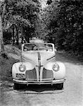 1940s - 1941 COUPLE MAN AND WOMAN IN PONTIAC CONVERTIBLE DRIVING ON COUNTRY LANE IN COUNTRYSIDE Stock Photo - Premium Rights-Managed, Artist: ClassicStock, Code: 846-05647647