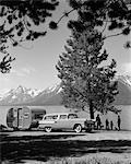 1950s FAMILY STATION WAGON & TRAILER PARKED JACKSON LAKE GRAND TETON MOUNTAINS IN THE BACKGROUND