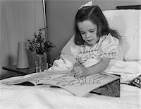 1960s LITTLE GIRL PATIENT IN HOSPITAL BED WRITING IN COLORING BOOK Stock Photo - Premium Rights-Managednull, Code: 846-05647690