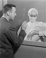 1950s FEMALE NURSE HOLDING INFANT UP TO FATHER AT NURSERY WINDOW Stock Photo - Premium Rights-Managednull, Code: 846-05647727