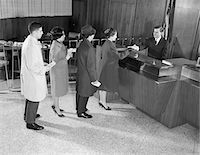 1960s PEOPLE WAITING IN LINE FOR BANK TELLER Stock Photo - Premium Rights-Managednull, Code: 846-05647751