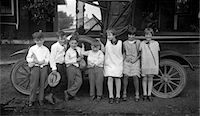 1910s CHILDREN LINED UP IN FRONT OF TRUCK FACING CAMERA Stock Photo - Premium Rights-Managednull, Code: 846-05647786