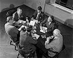 1950s - 1960s SIX BUSINESSMEN EXECUTIVES MANAGERS SALESMEN MEETING AROUND CORPORATE CONFERENCE TABLE