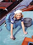 1940s SMILING BLOND TEEN WEARING SAILOR OUTFIT SCRUBBING SHIP DECK Stock Photo - Premium Rights-Managed, Artist: ClassicStock, Code: 846-05647827
